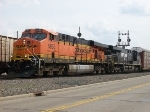 BNSF 5853 meets southbound grain at butler St.